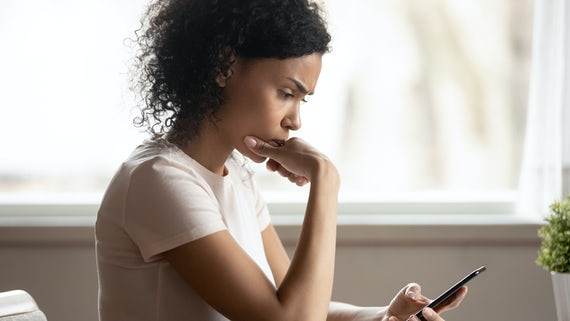 Stock image of a woman looking at a mobile phone