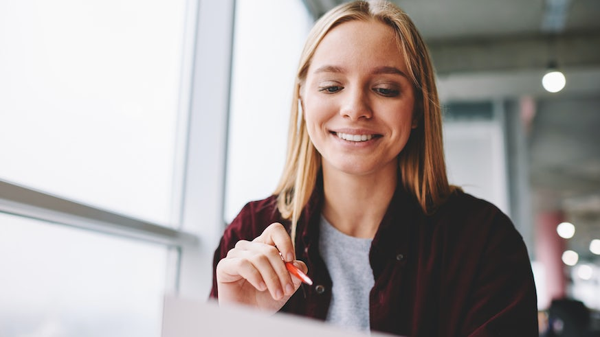 Stock image of woman filling in questionnaire