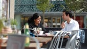 Man and woman chatting in cafe