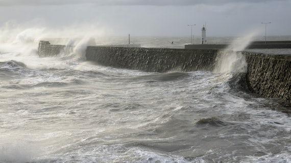Waves crashing against the coast