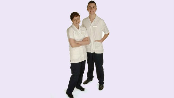 Male and female students modelling radiotherapy uniform for School of Healthcare Sciences