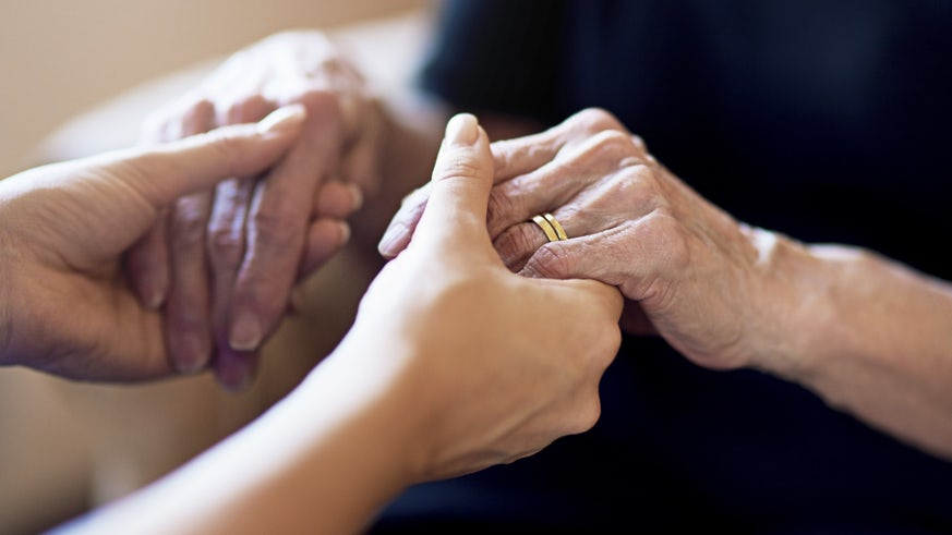 Holding hands of patient