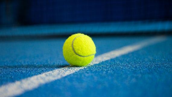 Tennis ball on white line
