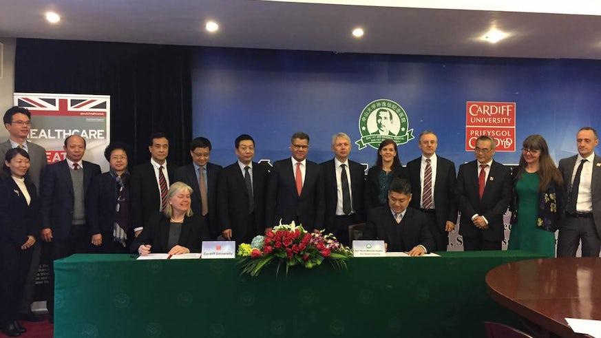 Professor Nora de Leeuw and Professor Erwei Song signing memorandum of understanding