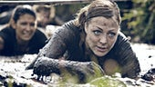 Women crawling through mud on course
