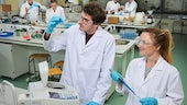 Students doing a practical experiment in the Pharmacy lab.