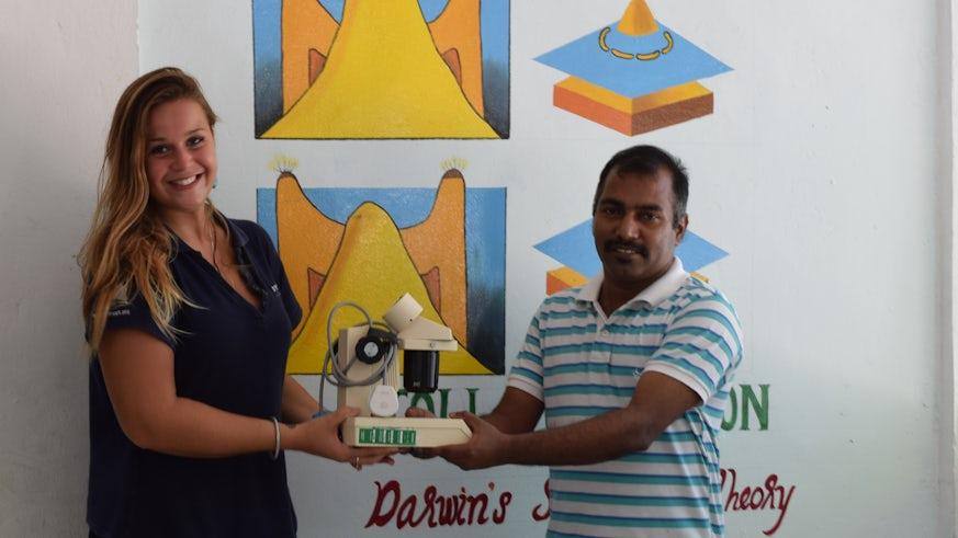 Beth Taylor presenting a microscope to Hithadoo School, Laamu Atoll