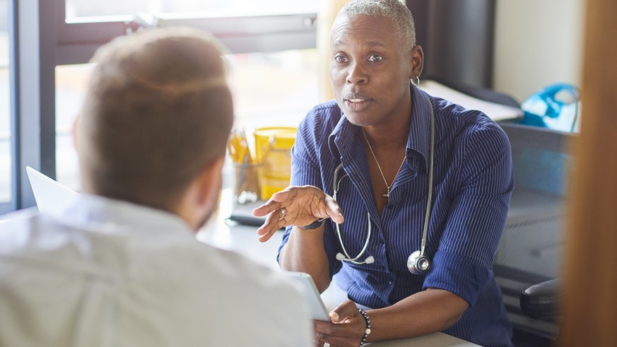 GP chatting to patient