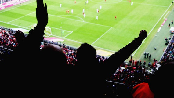 Fans cheering in football stadium