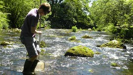 Student sampling in the river with net