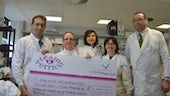 Team Verrico presenting donation in Institute lab
