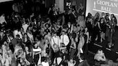 Black and white overhead image of multiple people on the dancefloor