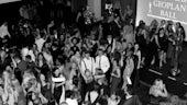 Black and white overhead image of multiple people on the dancefloor