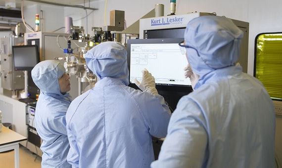 ICS process engineers working in the cleanroom.