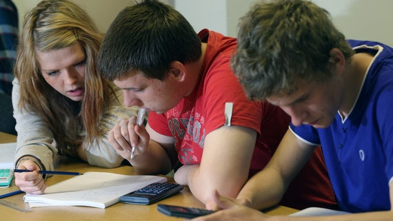 Three students in maths revision session