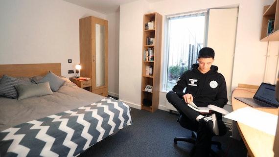 Student in halls bedroom