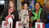Students with cuddly toys