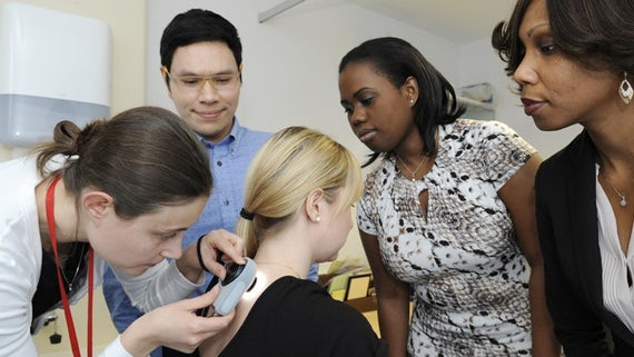 Students taking part in a dermatology course.