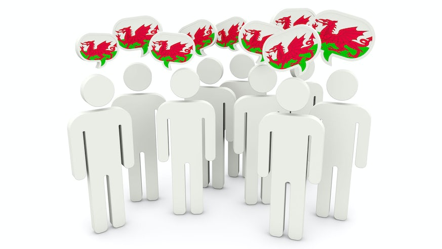 Stick figures with Welsh flag