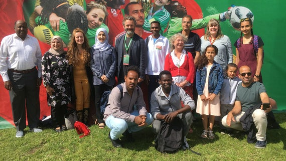 Michael Sheen with refugees from summer school