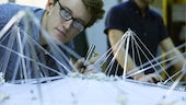 Student studying Engineering model