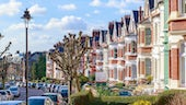 Row of typical English terraced houses in West Hampstead, London with a To Let sign outside stock image