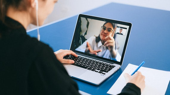 Laptop showing video chat in progress