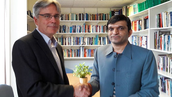 Professor Stuart Allan signs the new agreement with Associate Professor Dr Shahzad Ali of Bahauddin Zakariya University, Pakistan.