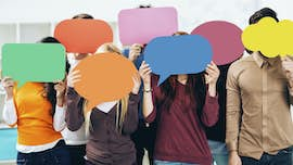 A group of people holding blank speech bubbles