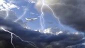 An aeroplane flies through lighning