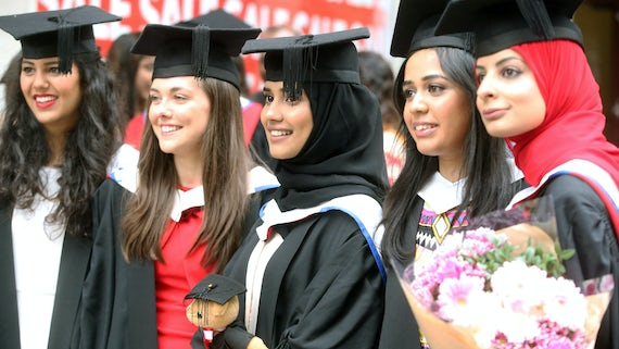 Five female graduands standing in a group.