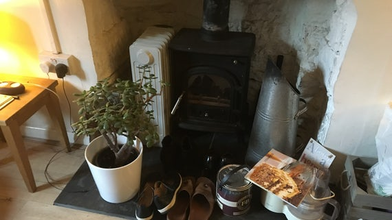 Photograph of objects around a fireplace in someone's home