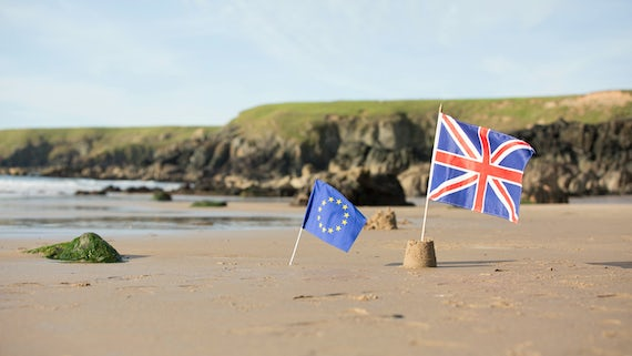 EU and UK flags on beach