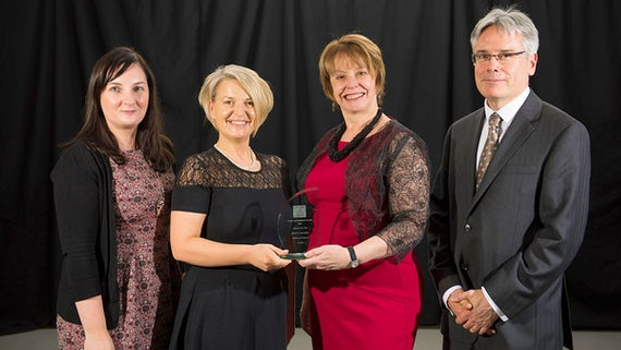 School staff receive the award