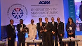 Image of Professor Peter Wells and Dr Maneesh Kumar, with other panel members, at the ACMA event in Pune, India