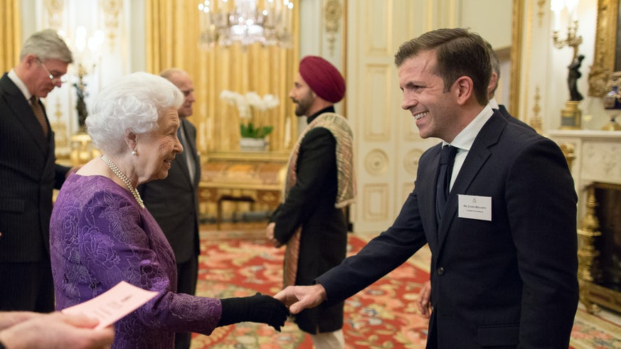 Reader in Asian Religions Dr James Hegarty meeting HM The Queen