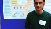 Syed Muaaz-Us-Salam with a poster explaining his work