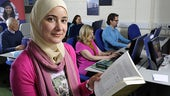 A female student in an IT lab