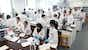 View image of Students in an undergraduate laboratory session.