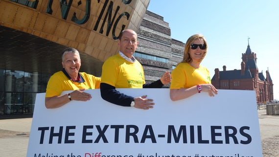Runners holding sign saying 'The Extra Milers'
