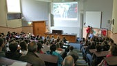 Public audience attending a talk in a lecture theatre