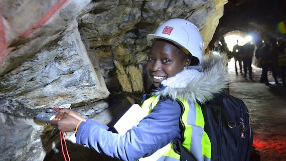 Student measuring cave wall
