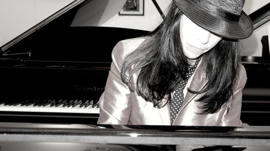 Photograph of Lola Perrin playing the piano