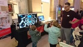 Children enjoying the spectroscopy display