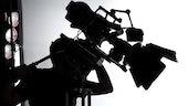 A Silhouette of a TV Camera