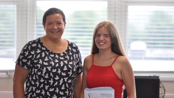 Megan Bone receiving her A level results with her headteacher Miss Rebecca Collins