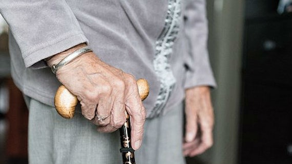 Patient with walking stick