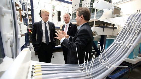 Jo Johnson, Universities and Science Minister with Professor Colin Riordan, Vice-Chancellor and Professor Manu Haddad, Director of the University's Morgan-Botti Lightning Laboratory