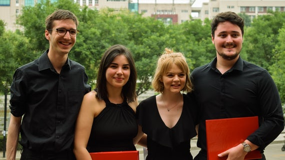Four students of Cardiff University Chamber Choir
