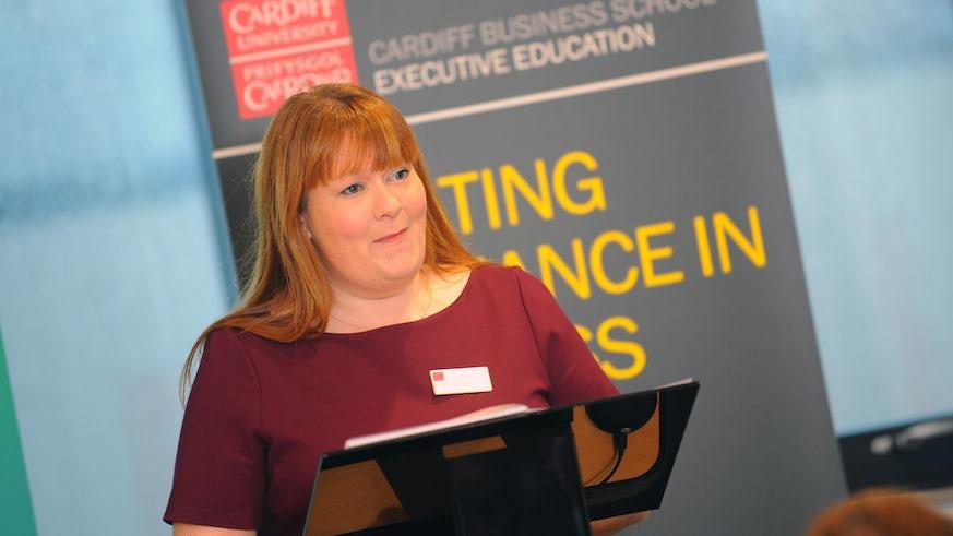 Woman presenting at podium
